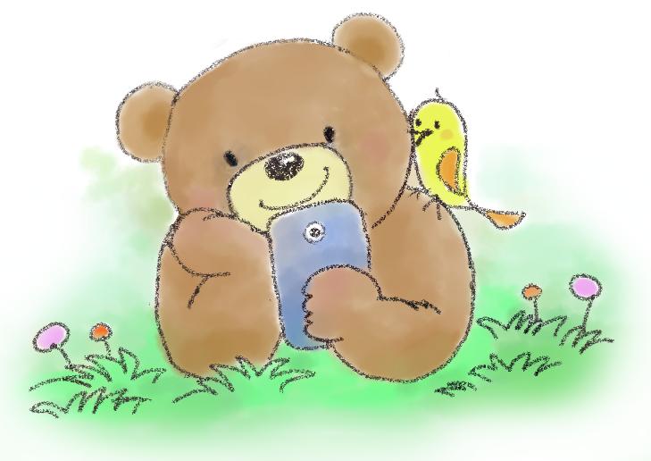 クマがスマホをいじっている画像